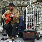 Street Musician in Old Quebec City by Laurel Talabere