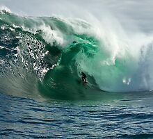A surfer in a massive barrel at Shipstern Bluff by andychiz