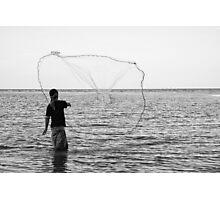 A Fisherman Casting Net Photographic Print