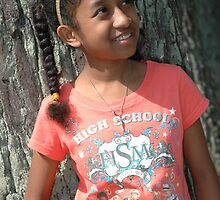 little girl stand up beside the tree by bayu harsa