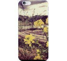 Fallen Log with Wildflowers Beside Riverbank iPhone Case/Skin