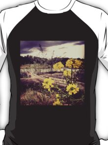 Fallen Log with Wildflowers Beside Riverbank T-Shirt
