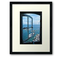 Miniatures through the window Framed Print