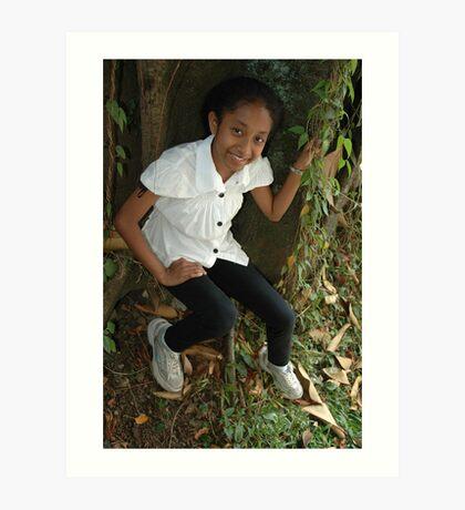 little girl sit down beside the tree Art Print