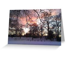 Sunset over a snowy scene Greeting Card