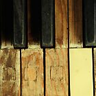 Old piano keys by farcaphoto