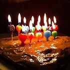 happy birthday cake with candles by Matte Downey