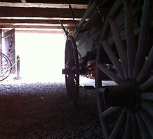 old wagon in shed with open door by Matte Downey
