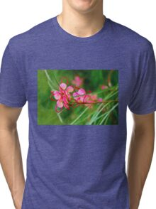 Floral background of grass and red flowers  Tri-blend T-Shirt