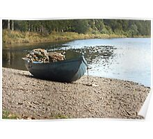 Boat on river bank Poster