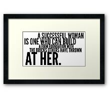 A successful woman is one who can build a firm foundation with the bricks others have thrown at her Framed Print
