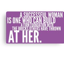 A successful woman is one who can build a firm foundation with the bricks others have thrown at her Canvas Print
