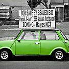 Parked Green Mini Cooper by Arjuna Ravikumar