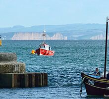 Red Boat Coming Into Lyme Harbour by lynn carter