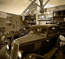 Vintage English car in old workshop by Martyn Franklin
