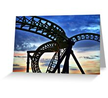 Coaster - Twisting frame of a roller coaster taken against a pastel sunrise Greeting Card