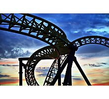 Coaster - Twisting frame of a roller coaster taken against a pastel sunrise Photographic Print