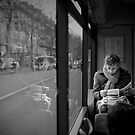 Reading in the bus by Laurent Hunziker