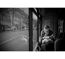 Reading in the bus Photographic Print