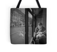 Reading in the bus Tote Bag