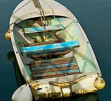 Old dinghy in Weymouth marina, Dorset, UK by buttonpresser