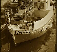 Boat in Weymouth harbour, Dorset, UK by buttonpresser