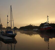 Mist at Dawn on the Caledonian Canal at Banavie. by John Cameron
