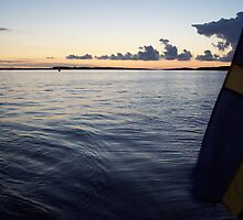 Swedish Flag Trailing Behind Our Sailboat - Gothenburg, Sweden by Nina Brandin
