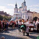 Folk dancing in Prague square by doug hunwick