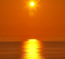 Sunset over the Irish Sea at Morfa Bychan by rwmilnes