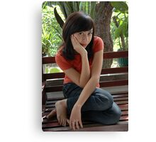 young girl sit down on wood chair Canvas Print