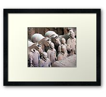 Losing your head Framed Print