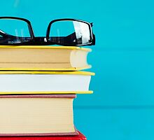 Black glasses and old books.  by saaton