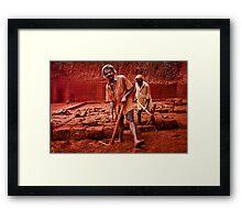 red men Framed Print