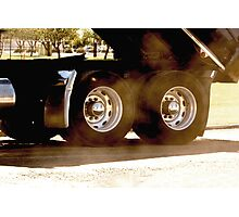 Trucks - Rear Wheels & Axel Detail of a Dump Truck with Dust Flying Photographic Print