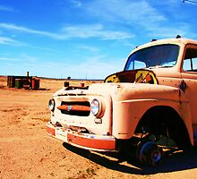 Lonely desert truck by Lainey Brown
