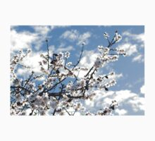 Blossoms against the blue sky Kids Tee