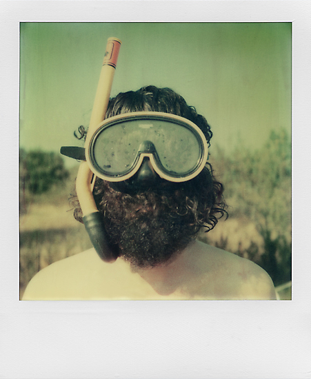 Fins, goggles and rifle by Ale Di Gangi