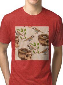 black and white illustration of birds making a nest in animal skull Tri-blend T-Shirt