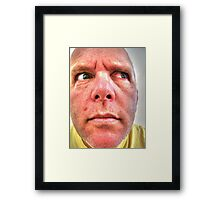 Man with angry, suspicious look on his face Framed Print