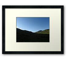 Sun Setting behind Green Mountains Framed Print