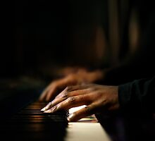Hands playing piano close-up by johanswanepoel