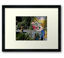 Burmese dancers at Portmeirion, Wales, UK Framed Print