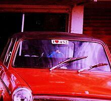 My old orange Austin  by Alain Christopher