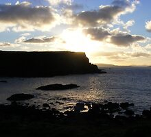 Giant's Causeway - sinking sun by monkeyferret