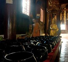 Prayer Bowls in a Buddhist Temple by Sergey Kahn