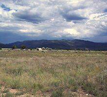 Desert meets Mountains and Storm, New Mexico by David  Hughes