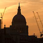 St Paul's Cathedral against the rising sun. by Russell Bruce