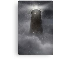 An old lighhouse with clouds and snow falling. Canvas Print