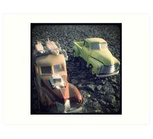 two matchbox trucks on the road Art Print